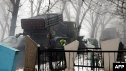 A pro-Russian separatists' Grad rocket launcher is parked in front of a cemetery in Donetsk on January 20, 2015