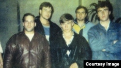 "Sergei Miskaryov (left), nicknamed ""Broiler,"" with a group of associates in St. Petersburg in the 1990s. (Photo courtesy of the Agency of Journalistic Investigations.)"