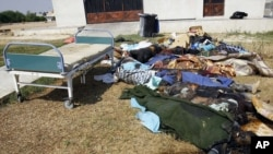 Libya -- Dead bodies lay outside the hospital in the Abu Salim district in Tripoli, 26Aug2011