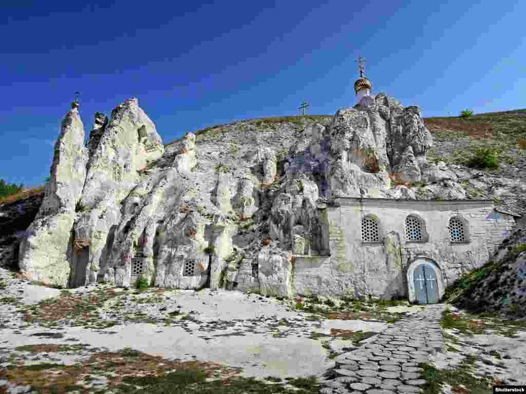 """Lylova says the ancient Cave Monastery of St. John The Baptist (pictured) had tiles laid by the Orthodox church management """"because the chalk [floor] stained clothes."""" Historical irregularities in the interior were also smoothed over. Lylova told RFE/RL that if the church gains control of the Sicilia cave temple """"there is no hope, even with all the assurances and promises, it will retain its current appearance."""""""