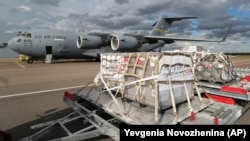 A shipment containing medical aid from the United States, including 50 ventilators, is unloaded from a U.S. Air Force C-17 transport plane at Vnukovo International Airport in Moscow on May 21.