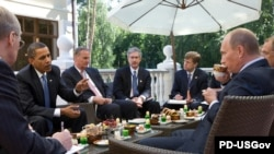 U.S. President Barack Obama (second from left) and Russian Prime Minister Vladimir Putin (right) meet at the latter's country residence outside Moscow in July 2009.