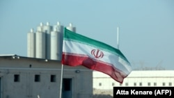 An Iranian flag flies in Iran's Bushehr nuclear power plant, during an official ceremony to kick-start works on a second reactor at the facility, November 10, 2019