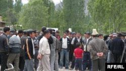 Residents of the village of Sogment gather at the Kyrgyz-Uzbek border. Political tensions often mean that enclave residents are cut off from the wider world.