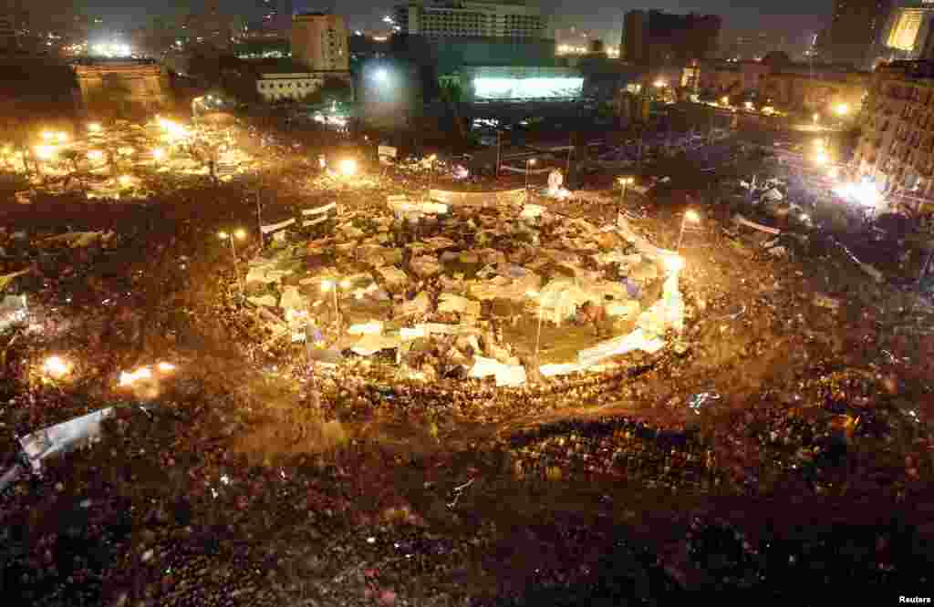 Protesters celebrate in Tahrir Square after the announcement of Egyptian President Hosni Mubarak's resignation on February 11. An estimated 2 million people took part in the demonstrations that forced Mubarak out after nearly three decades in power. (