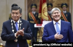 Happier times: Atambaev (right) with Kyrgyz President Sooronbai Jeenbekov at Jeenbekov's inauguration in November 2017