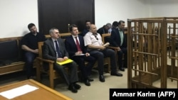 Members of the Russian diplomatic corps attending the trial in Baghdad of two Russian women sentenced to life in prison for Islamic State ties on April 17.