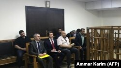 IRAQ --Members of the Russian diplomatic corps attend the trial of two Russian nationals at the Central penal Court in Baghdad, April 17, 2018