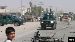 Wreckage after the earlier attack on the security firm in Kandahar