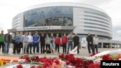 Mourners place flowers at the hockey arena in Minsk that was to have been the site of the team's season-opening game on September 9.