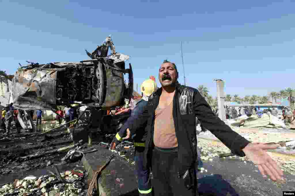 A man reacts at the site of a bomb attack in the city of Hilla, south of Baghdad, on March 6. (Reuters/Alaa al-Marjani)