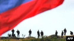 Russian soldiers await their departure from a checkpoint in a breakaway region of Georgia in 2008, when the countries fought a brief but deadly war.