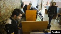 Browsers at an Internet cafe in Tehran (file photo)