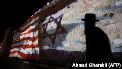 The Israeli and U.S. flags are projected onto the walls of the ramparts of Jerusalem's Old City, to mark one year since the transfer of the U.S. Embassy from Tel Aviv to Jerusalem.