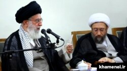 Ali Khamenei, (L) Iran's Supreme Leader and Sadeq Amoli Larijani. June 22, 2014.