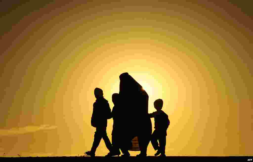 An Afghan family during sunset in Herat. (AFP/Aref Karimi)