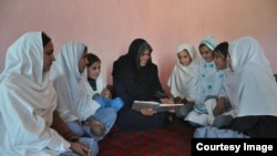 Aqeela Asifi with her students.