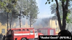 Firefighters battle the blaze at Khujand University's Arts Faculty.