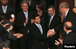 House Speaker-elect Paul Ryan is congratulated by members of the House as he enters the House Chamber after winning the votes neccessary to become the next Speaker of the House on Capitol Hill in Washington October 29, 2015.