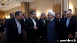 President Hassan Rouhani attends a meeting with a group of foreign ministry officials in Tehran, Iran, Sunday, July 22, 2018.