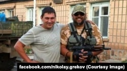 Мэр Александровска Николай Греков (справа)