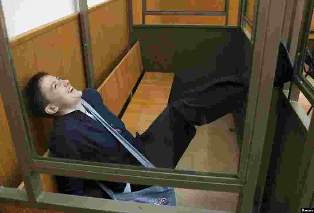 Ukrainian Army pilot Nadia Savchenko reacts from a glass-walled cage during a verdict hearing at a court in the southern border town of Donetsk in Russia's Rostov region. She was sentenced to 18 years for complicity in the deaths of two Russian journalists during fighting in eastern Ukraine in June 2014. She was sentenced to 10 years for complicity in the attempted killings of other civilians in the same incident. (Reuters/Maxim Shemetov)