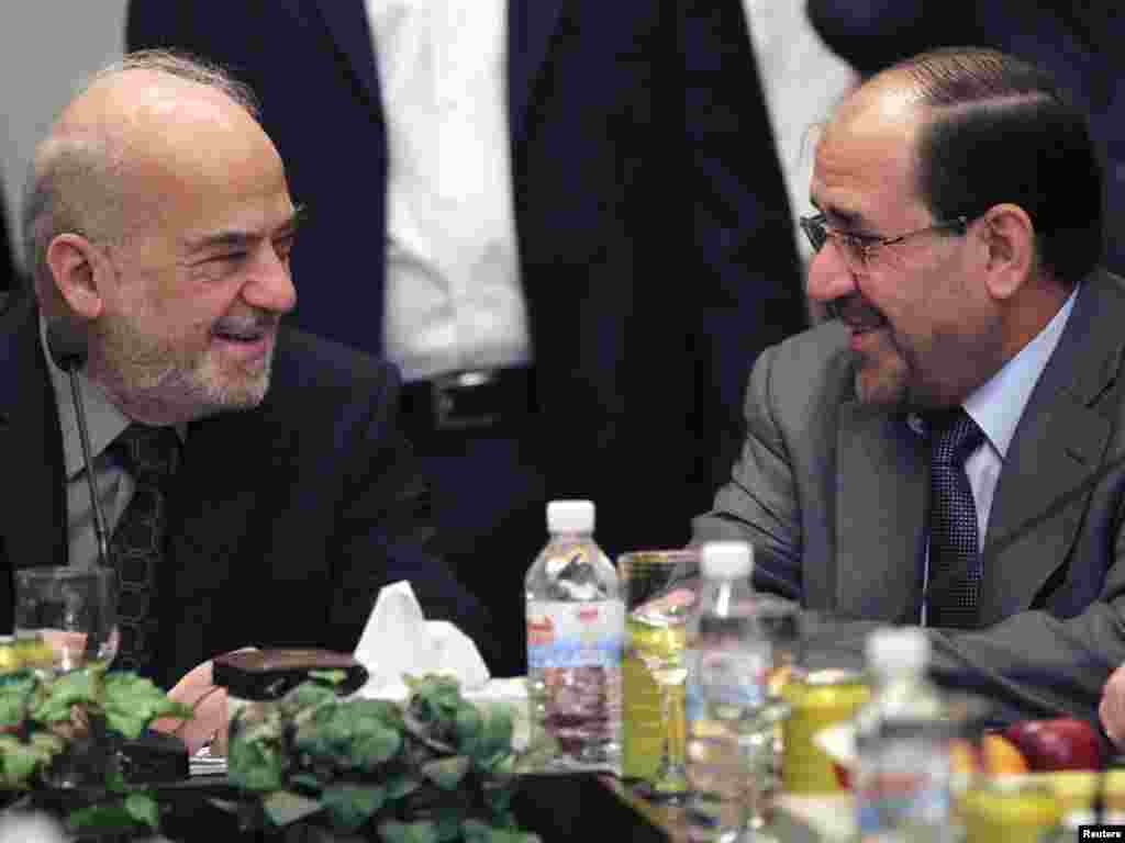 Iraq -- Prime Minister Nuri al-Maliki (R) speaks with the head of Current National Reform Ibrahim al-Jaafari during a meeting for the National Alliance in Baghdad, 25Oct2010 - Iraq's Prime Minister Nuri al-Maliki (R) speaks with former prime minister and the head of Current National Reform Ibrahim al-Jaafari during a meeting for the National Alliance in Baghdad October 25, 2010. The pace of coalition talks in Iraq may speed up after a court told parliament to convene and political blocs agreed to meet, putting pressure on the Kurds to pick a winning side seven months after an inconclusive election. Picture taken October 25, 2010. REUTERS/Mohammed Ameen (IRAQ - Tags: POLITICS)