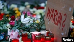 "A sign reading ""Why?"" is placed at the Christmas market in Berlin, the site of the deadly truck attack."