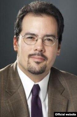 Исполнительный директор Международного форума демократических исследований в Национальном фонде демократии Крис Уокер.