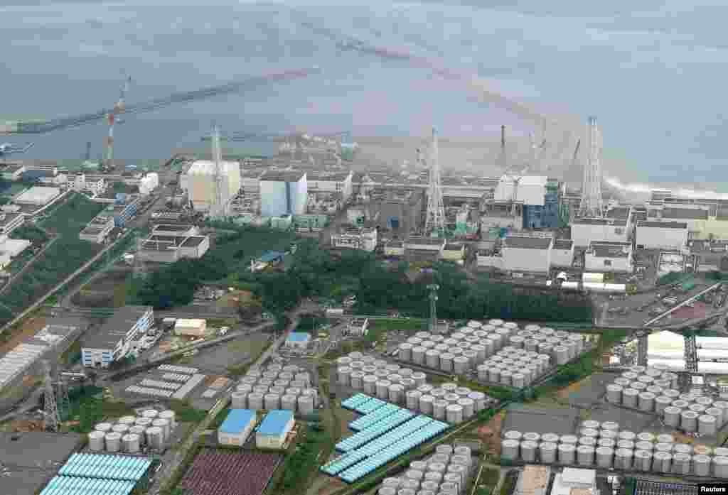 An aerial view of the Fukushima plant and its contaminated water storage tanks. In August, TEPCO said that 300 tons of water had leaked from one of the tanks.