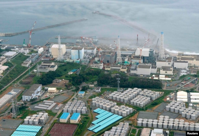 An aerial view of the Fukushima plant and its contaminated-water storage tanks (bottom)