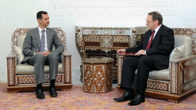 Syrian President Bashar al-Assad (left) meets with Russian Deputy Foreign Minister Mikhail Bogdanov in Damascus in August 2011.