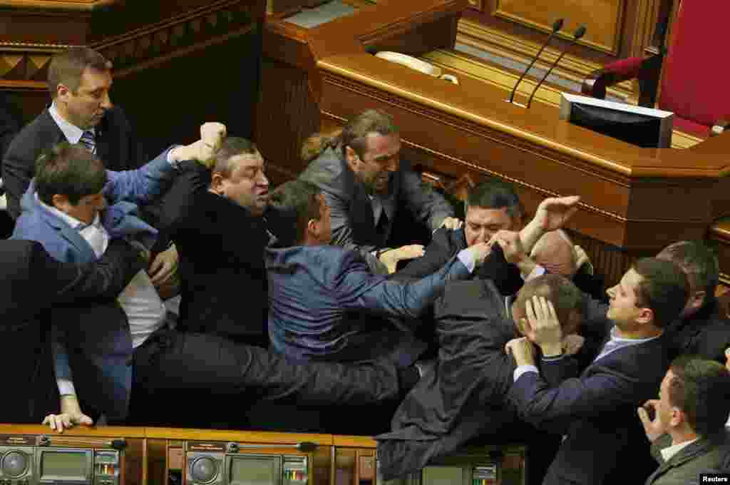 Deputies clash during a session of the Ukrainian parliament in Kyiv on April 8. (Reuters/Valentyn Ogirenko)