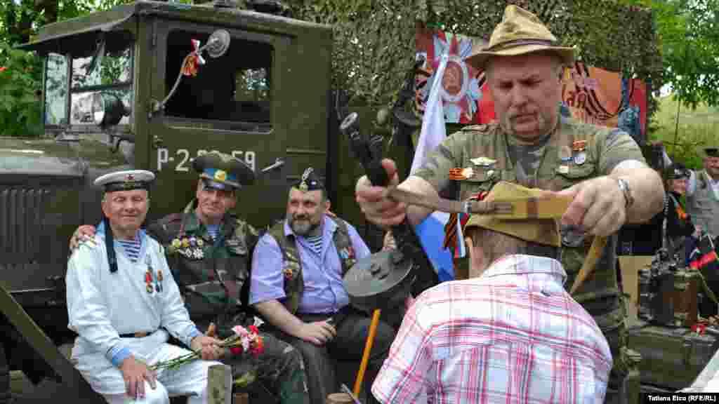 People in Chisinau, Moldova, wear wartime uniforms.