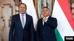 Russian Foreign Minister Sergei Lavrov (left) meets with Hungarian Prime Minister Viktor Orban in Budapest on May 25.