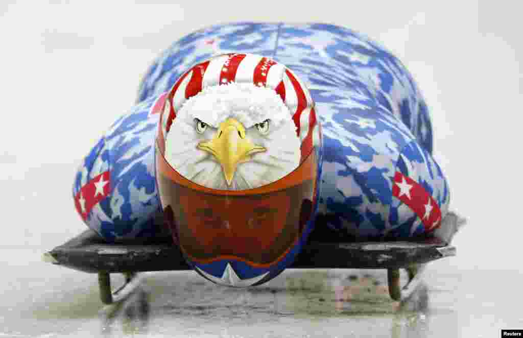 Katie Uhlaender of the United States speeds down the track during a women's skeleton training session at the Sanki sliding center in Rosa Khutor.