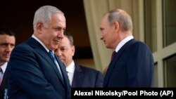 The downing of a Russian plane in Syria is a source of potential discord between Israel and Moscow. Pictured: Israeli Prime Minister Benjamin Netanyahu (left) and Russian President Vladimir Putin (file photo).