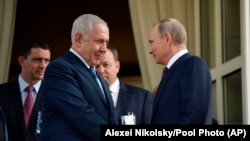 Russian President Vladimir Putin, right, and Israeli Prime Minister Benjamin Netanyahu shake hands after their talks in the Black Sea resort of Sochi, Russia, Wednesday, Aug. 23, 2017.