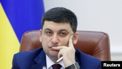 The IMF says it is encouraged by signs from Ukraine's new government headed by Prime Minister Volodymyr Hroysman.