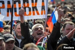 A man shouts during a pro-Russia rally near the regional government building in Donetsk in April 2014.