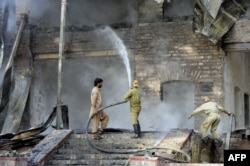 Firefighters extinguish the fire that gutted the Ziarat residency.