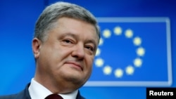 "Ukrainian President Petro Poroshenko has described the introduction of visa-free travel to the EU for citizens of his country as ""historic."""