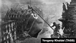 Is it 1945 all over again? Red Army soldiers hoist the Soviet flag over the Reichstag in Berlin at the end of World War II.
