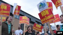 Local residents demonstrate in Saint-Hyacinthe, Canada, before a public meeting called by the shale-gas industry in September 2010.