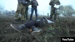 Кадр из репортажа российского телеканала о событиях в Украине.