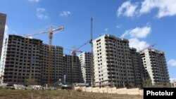 Armenia - New apartment blocks are constructed in Yerevan, 4Apr2015.