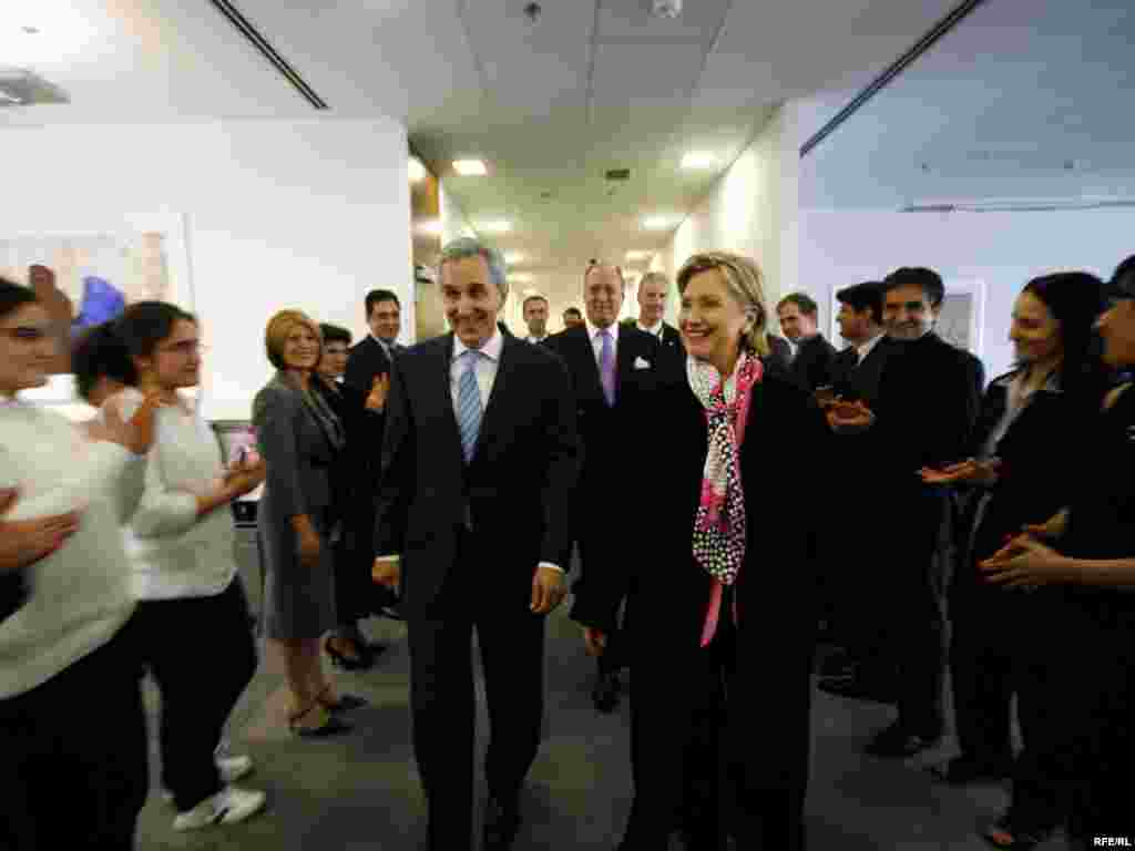 Secretary Clinton is greeted by the staff of Radio Free Afghanistan.