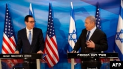 Israeli Prime Minister Benjamin Netanyahu speaks during a joint press conference with US Treasury Secretary Steven Mnuchin (L) in Jerusalem October 28, 2019.