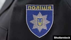 "Ukraine – Chevron ukrainian policeman in uniform with the inscription ""Police"" in the Ukrainian language"