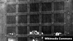 Леон Чолгош за решеткой, первое фото после ареста, сентябрь 1901